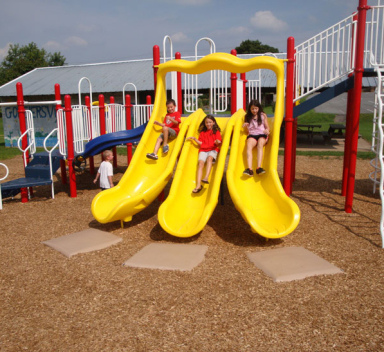 children sliding down a slide