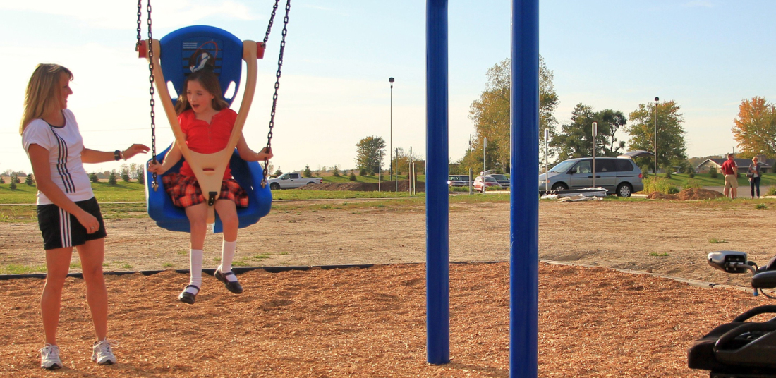 reike park woman pushing girl on a swing