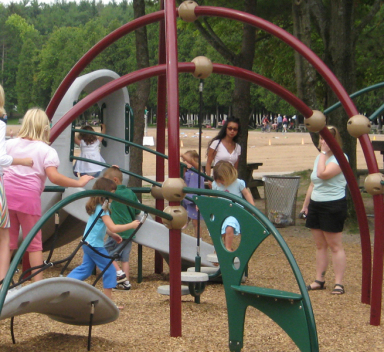 children playing at a playground in green lakes state park